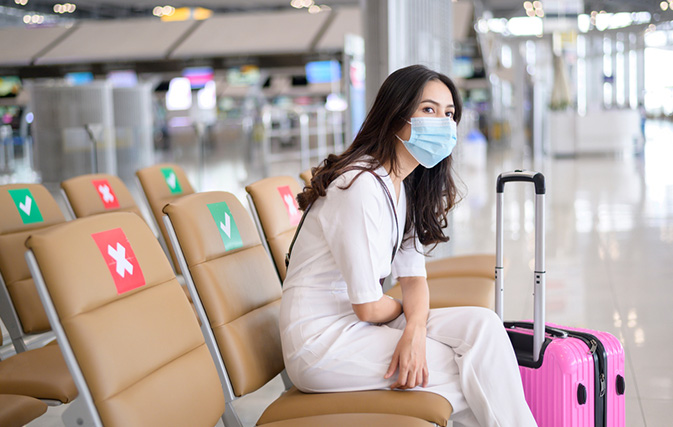 Traveller at airport with mask
